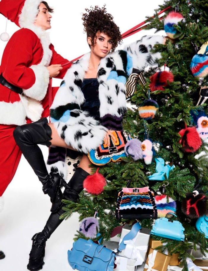 Next to a Christmas tree, Sara Sampaio wears Fendi fur and ruffled boots