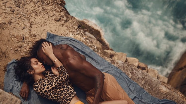 Shanina Shaik and DJ Ruckus get captured in an intimate pose. Shanina wears Zara top and Matteau bikini briefs