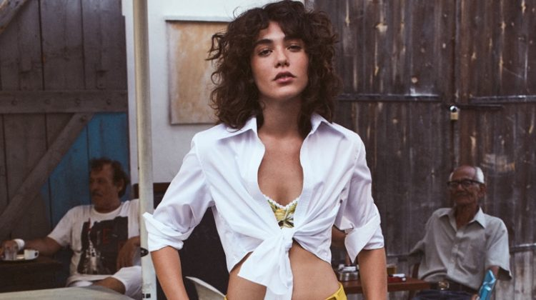 Model Steffy Argelich wears Johanna Ortiz shirt, Miguelina bra and Tibi pants