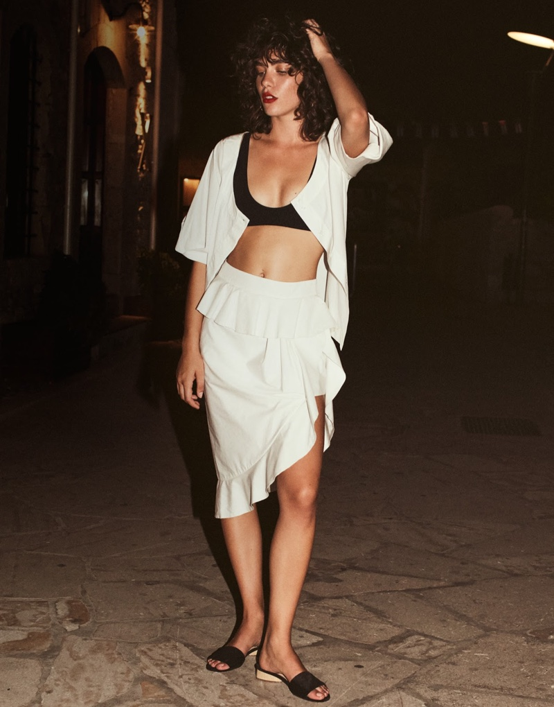 Keeping it casual, the model wears Isa Arfen blouse, Rochelle Sara bikini top and Michael Lo Sordo skirt