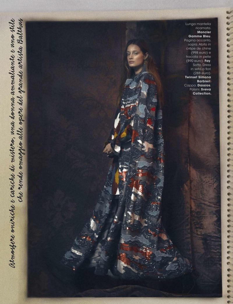 Model Thairine Garcia poses in Moncler Gamme Bleu embroidered long cape