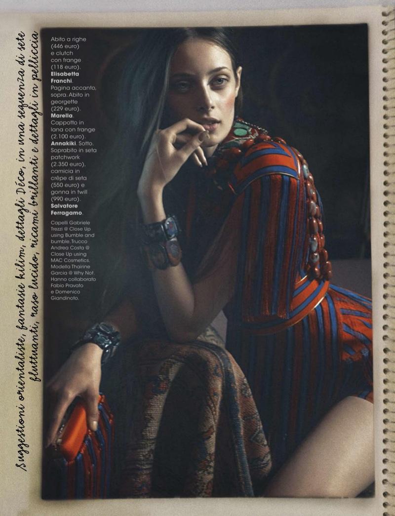 Thairine Garcia models Elisabetta Franchi dress and clutch