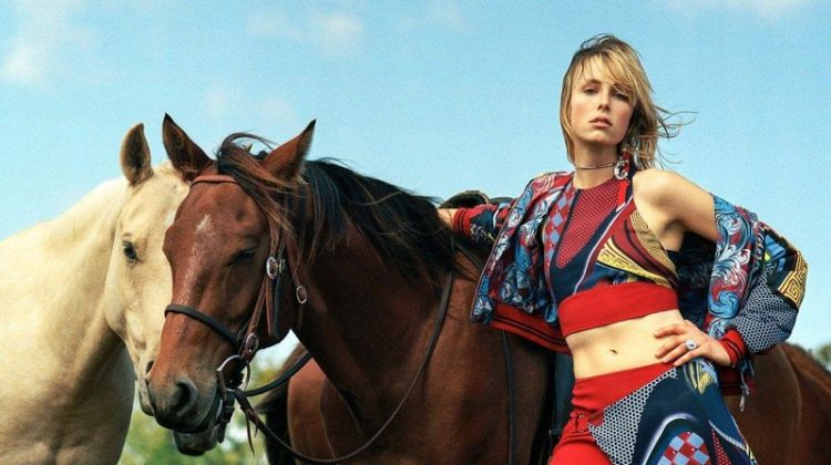 Model Edie Campbell poses next to a horse in Versace's spring 2017 campaign