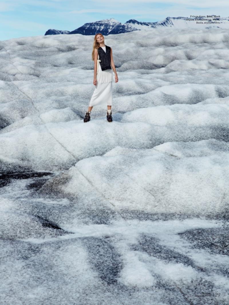 Standing on ice, Vika Falileeva models BOSS fringe dress with Marni sleeveless top