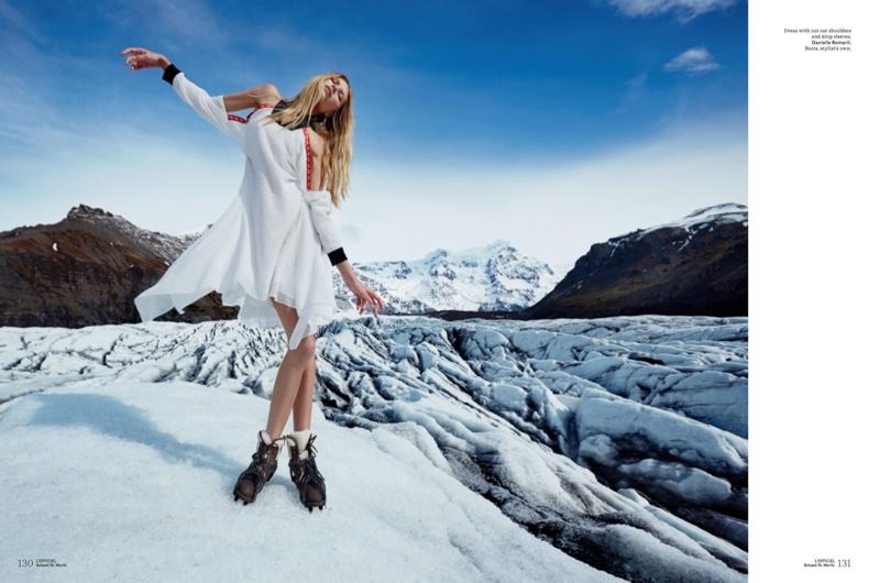 Vika Falileeva poses in Danielle Romeril dress with cutout shoulders