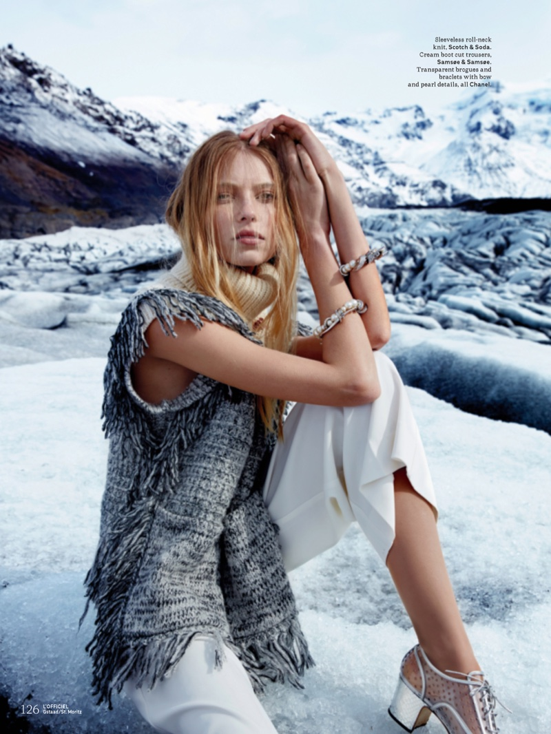 Model Vika Falileeva covers up in Scotch & Soda turtleneck, Samsee & Samsee trousers with Chanel brogues and bracelets