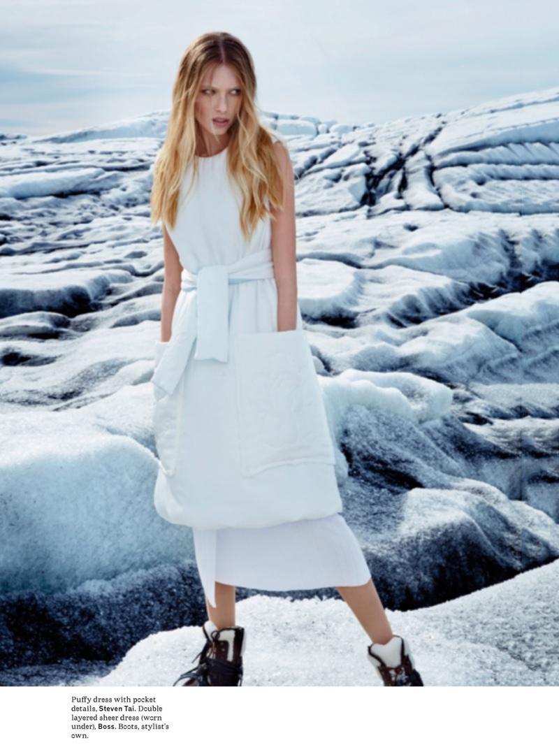 The model wears Steven Tai puffy dress over BOSS sheer dress