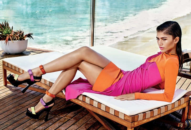 Zendaya poses by the beach in Versace dress and heels