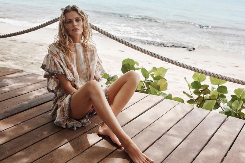 The model wears Zimmermann Tropicale Fringe Throw
