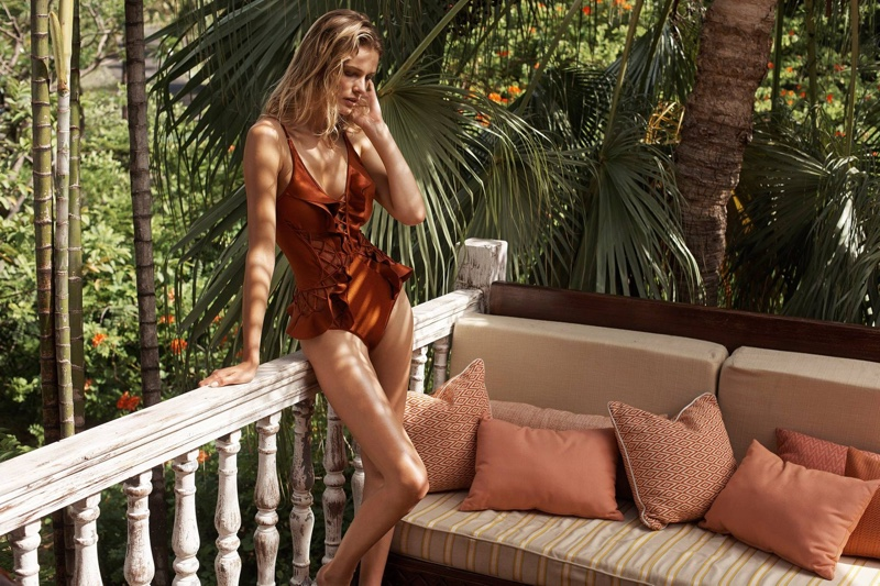 The model poses in Zimmermann The Oleander Lattice Flutter One-Piece Swimsuit