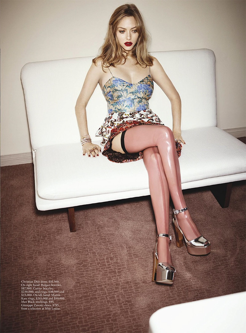Amanda Seyfried poses in Dior dress, Max Black stockings and Giuseppe Zanotti platforms