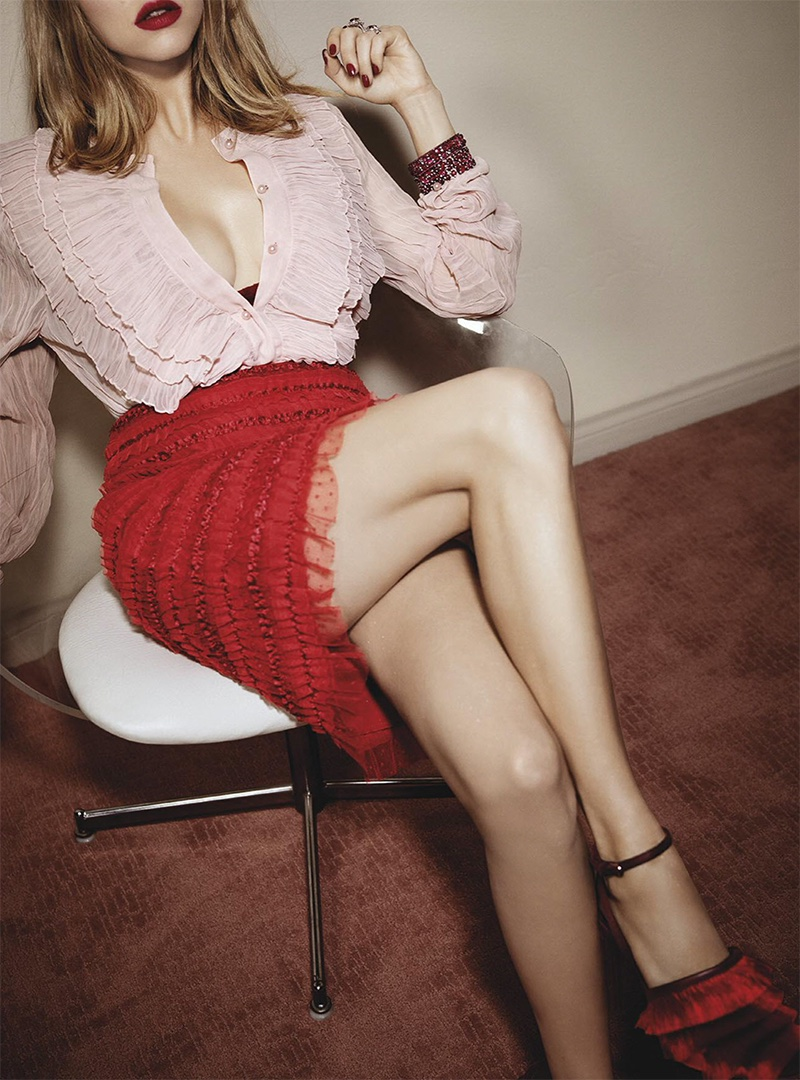 Wearing red and pink, Amanda Seyfried poses in Marco de Vincenzo heels