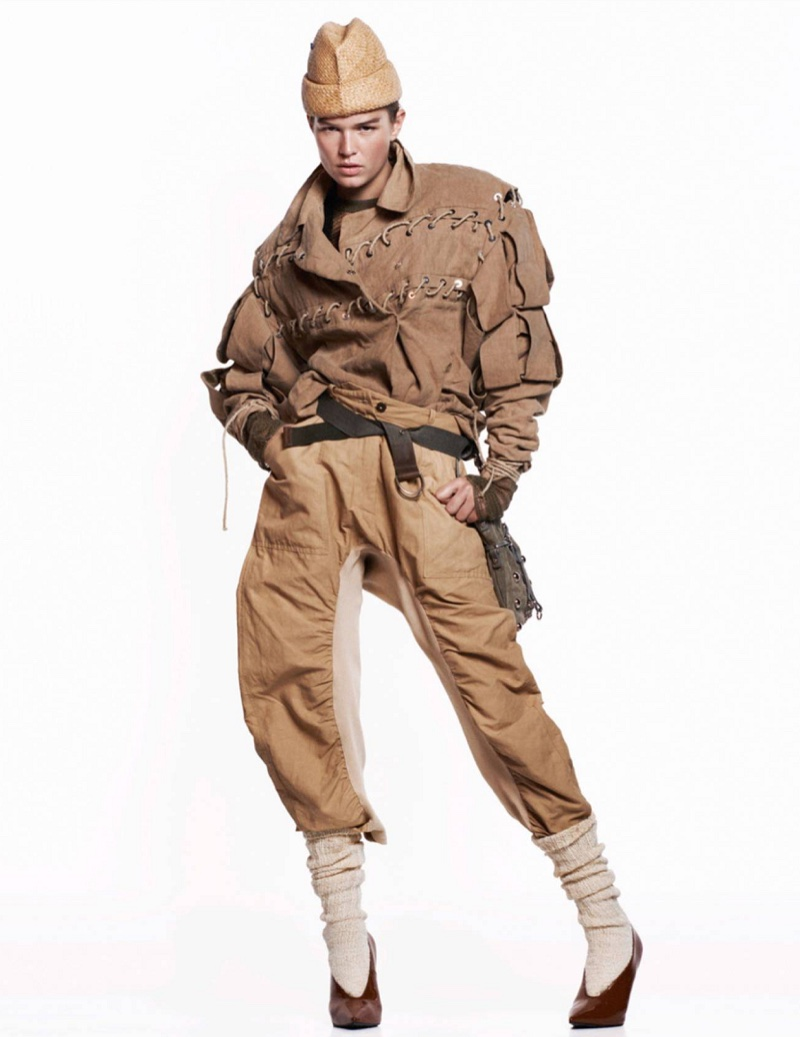 Model Anna Ewers poses in military inspired fashions for the editorial