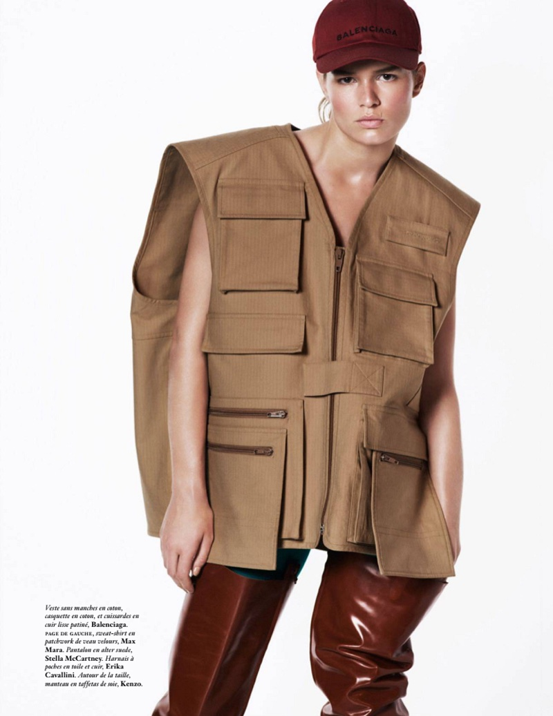Layering up, Anna Ewers model Balenciaga vest, hat and leather leg straps