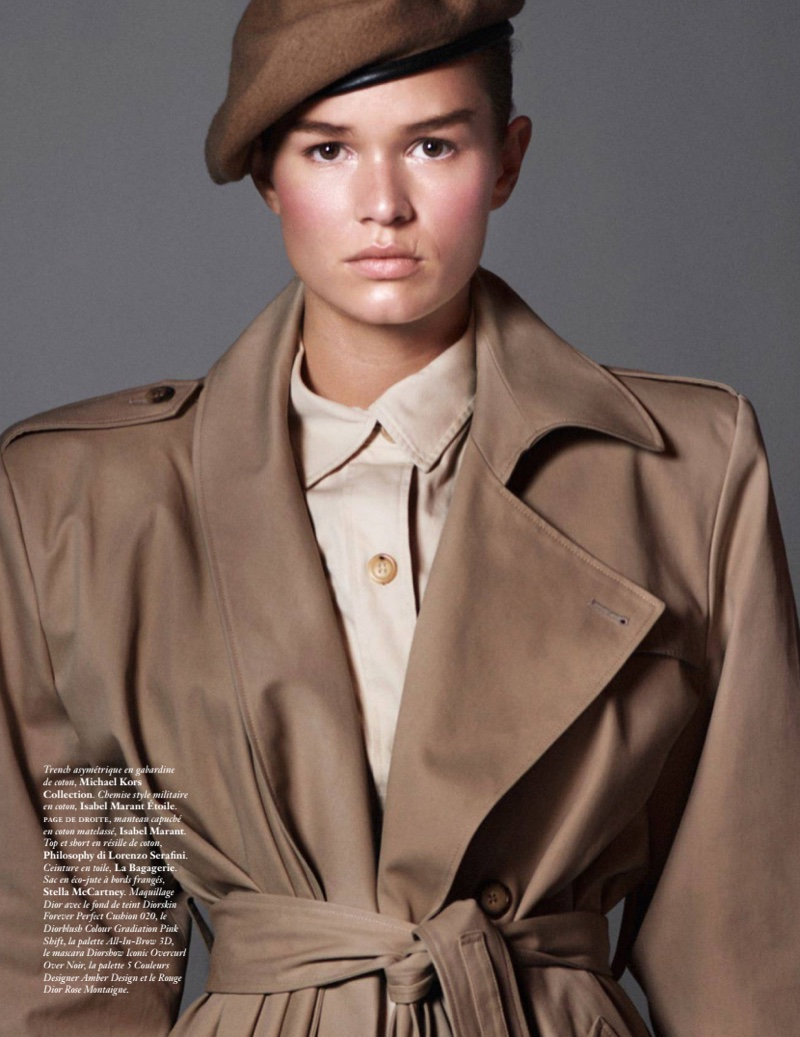Model Anna Ewers wears Michael Kors Collection trench coat with Isabel Marant Etoile top