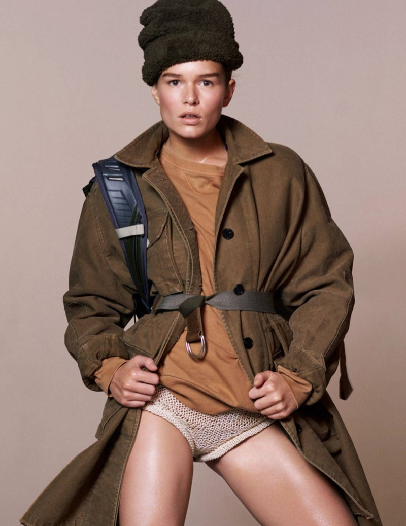 Model Anna Ewers wears Valentino coat, Dries Van Noten sweatshirt and Philosophy di Lorenzo Serafini short