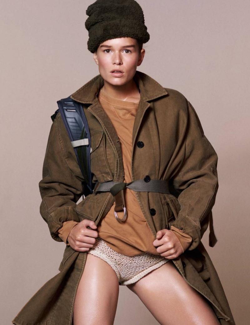 Model Anna Ewers wears Valentino coat, Dries Van Noten sweatshirt and Philosophy di Lorenzo Serafini short