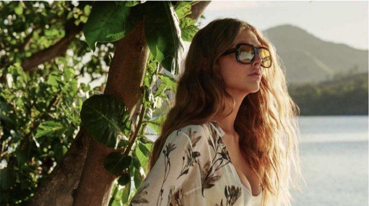 Model Bella Brown wears Morrison dress with Mikoh bikini top and Fella bikini briefs, and Gucci sunglasses