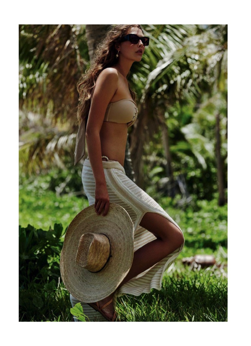 Bella Brown poses in Marysia bikini with Seafolly skirt, Communitie Marfa hat and Ammos sandals