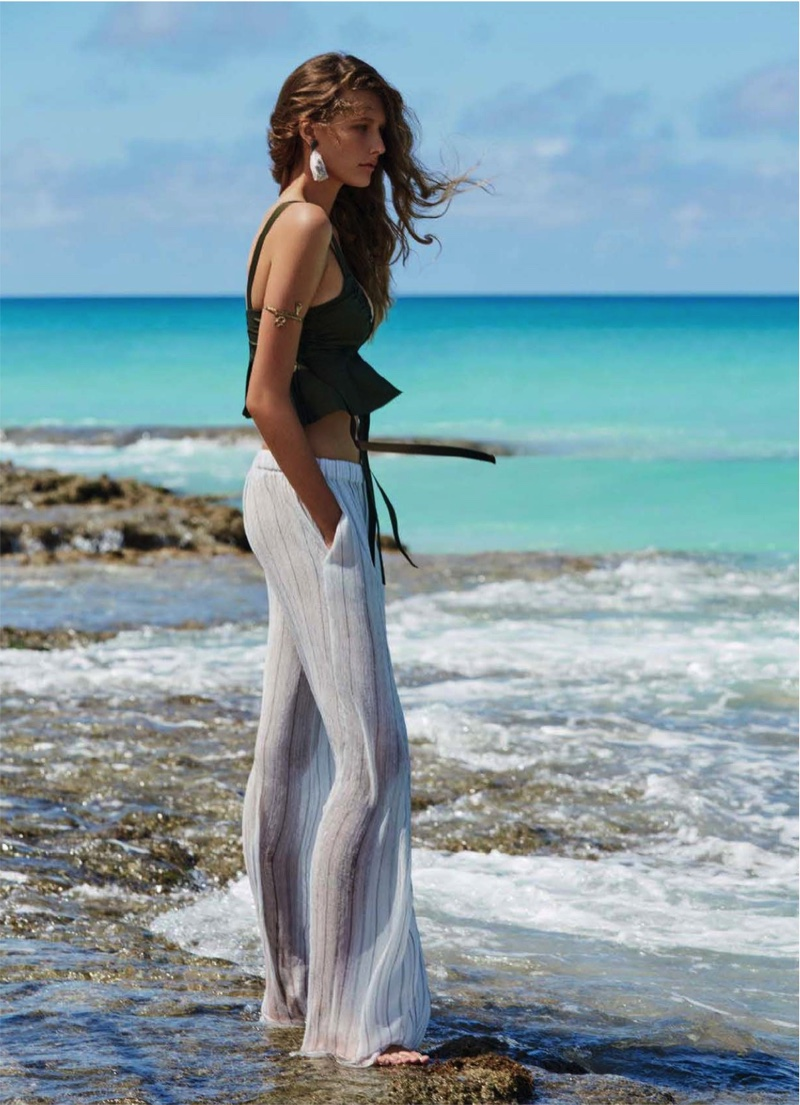Model Bella Brown poses in Manning Cartell top and Christopher Esber pants