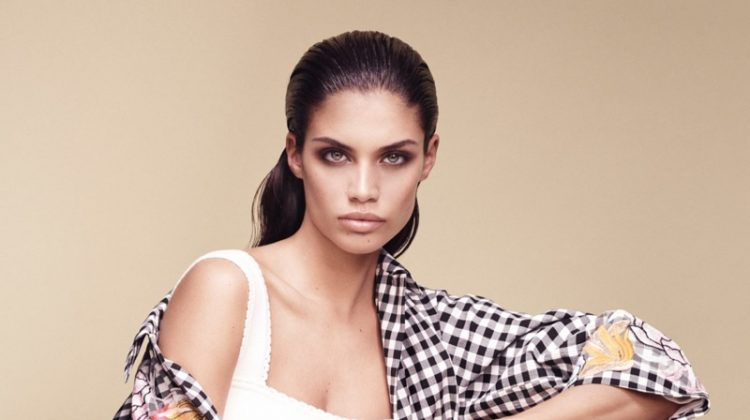 Model Sara Sampaio wears gingham and floral print coat from Blumarine's spring 2017 collection