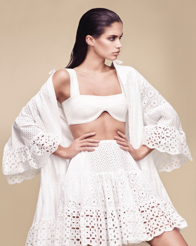 Dressed in white, Sara Sampaio models eyelet pieces from Blumarine's spring 2017 collection