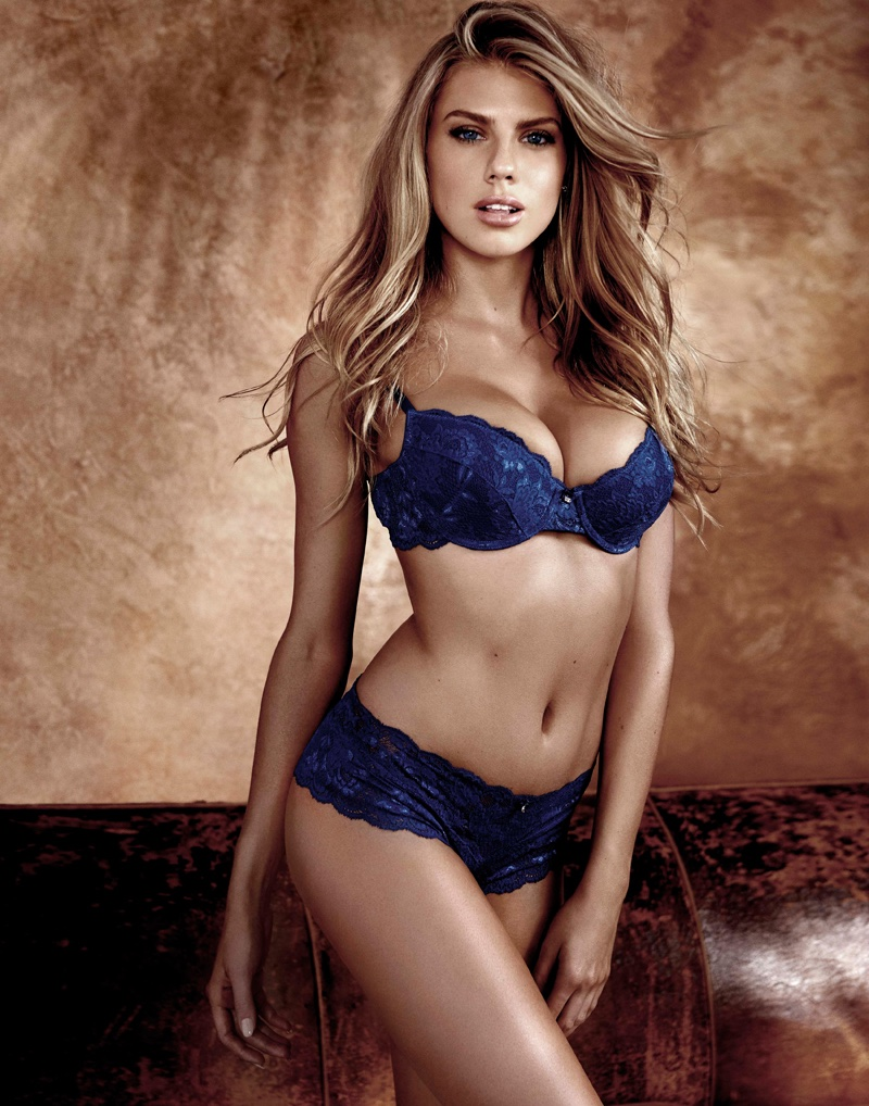 Model Charlotte McKinney poses in Guess blue bra and panty set
