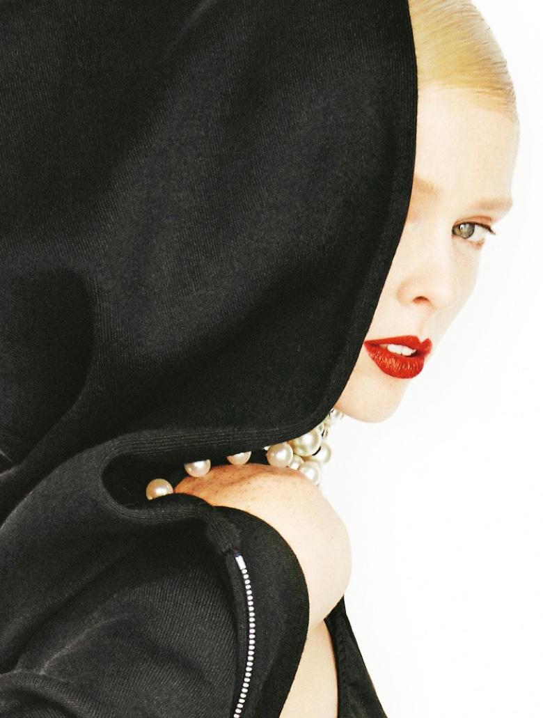 Getting her closeup, Coco Rocha wears red lipstick
