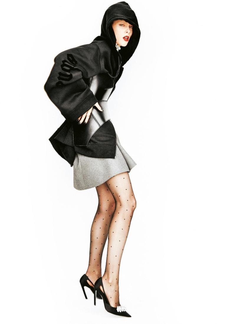Coco Rocha pulls shapes in Fenty x Puma hooded jacket