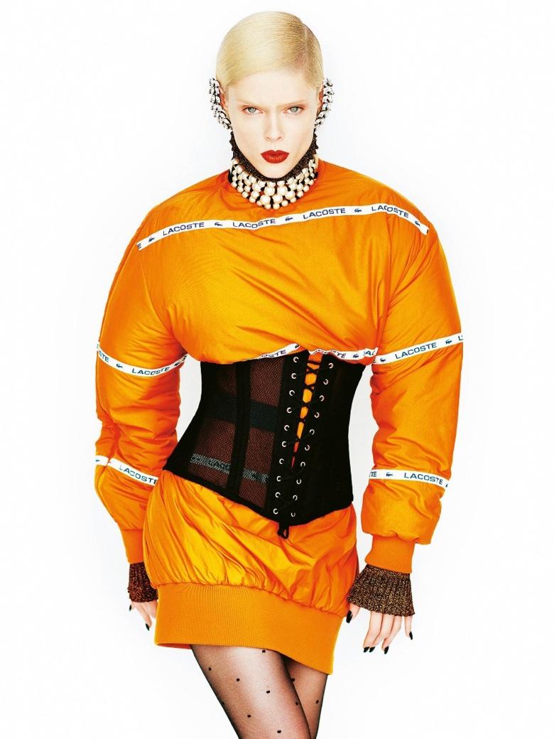 Coco Rocha wears orange Lacoste puffed sleeve dress