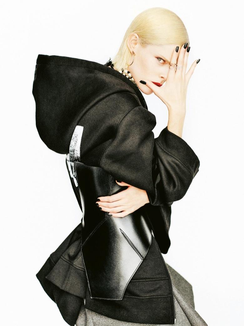 Coco Rocha strikes a pose in Fenty x Puma jacket
