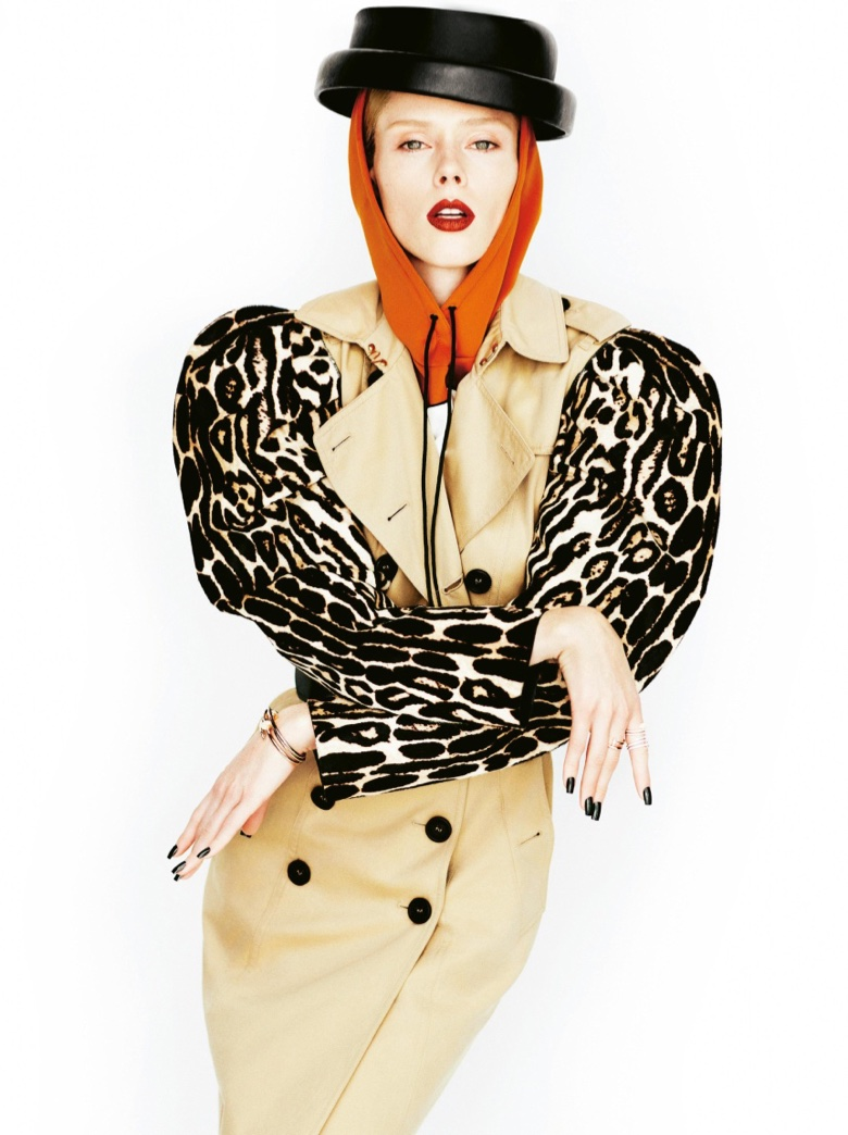 Striking a pose, Coco Rocha wears Burberry trench coat with animal print puffed sleeves