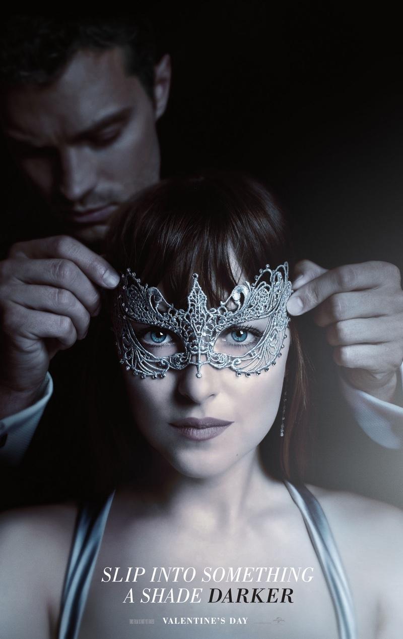 Wearing a mask, Dakota Johnson poses on Fifty Shades Darker poster