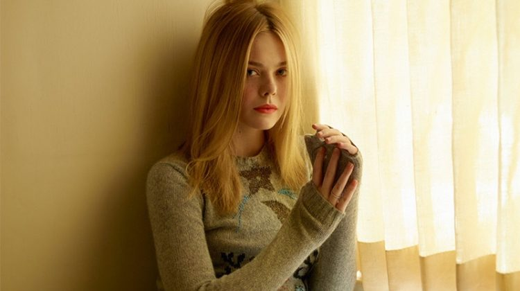 Actress Elle Fanning wears Dior sweater and tulle skirt