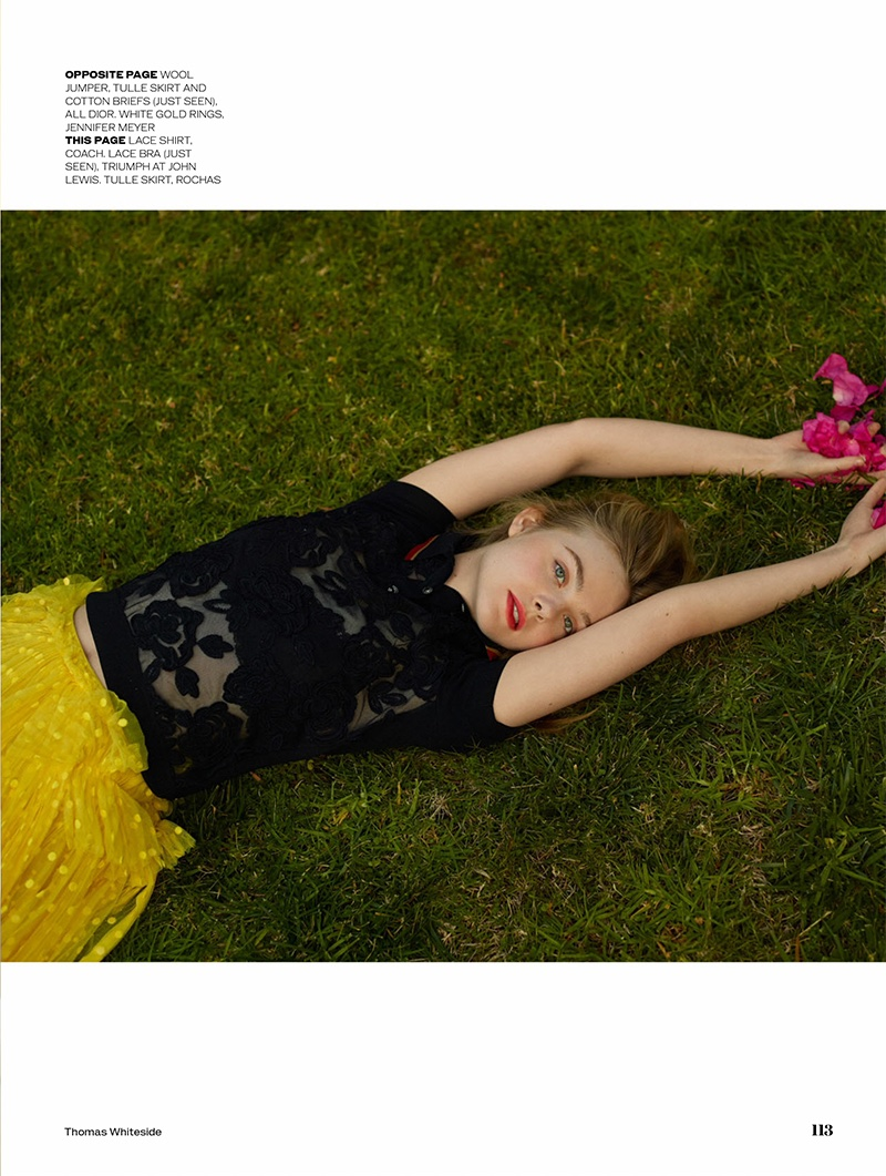Posing in grass, Elle Fanning models Coach lace shirt and Rochas tulle skirt