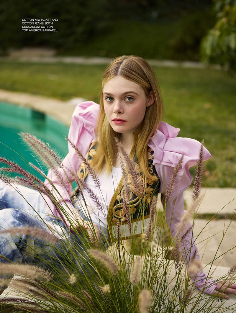 Elle Fanning lounges pool side in DSquared2 cotton-mix jacket and jeans