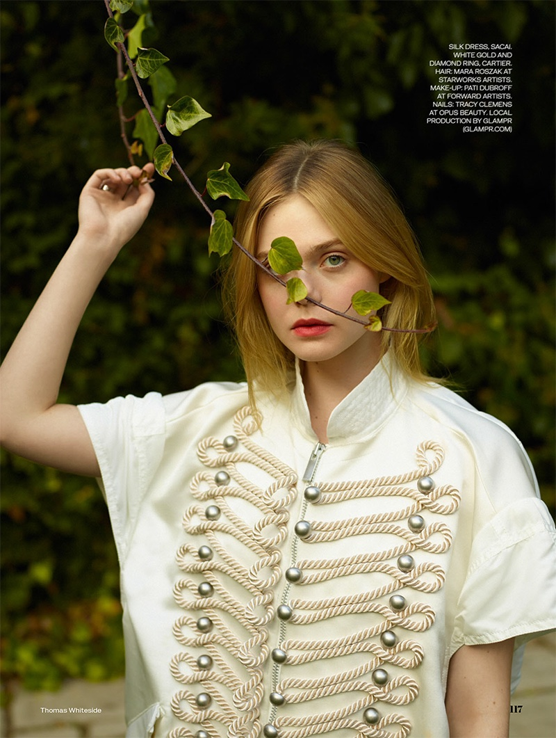 Posing outdoors, Elle Fanning wears Sacai embroidered silk dress