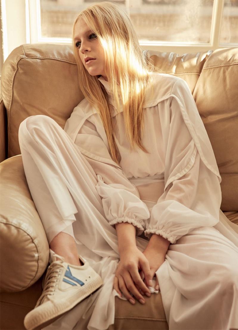 The model wears Celine silk jersey dress and shoes