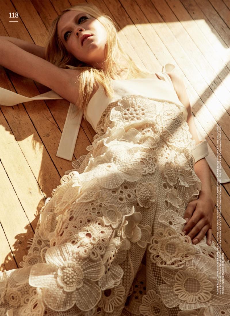 Emilie Evander poses in Chloe white floral embellished jumpsuit