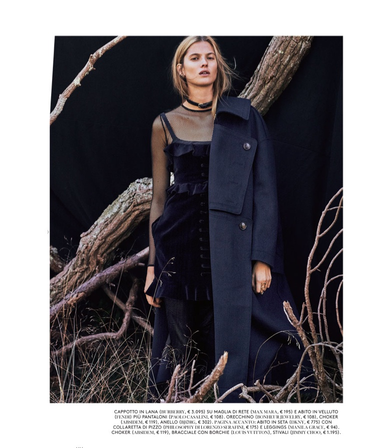 Covering up, Estee Rammant wears Burberry wool coat, Max Mara mesh top and Fendi velvet dress
