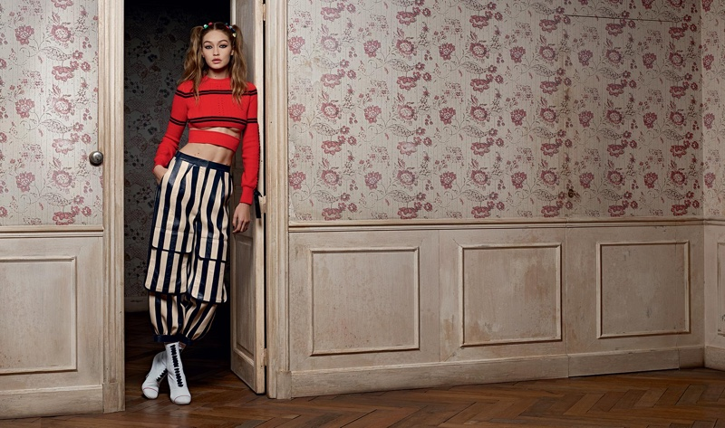 Model Gigi Hadid wears cropped sweater and striped pants in Fendi's spring 2017 campaign