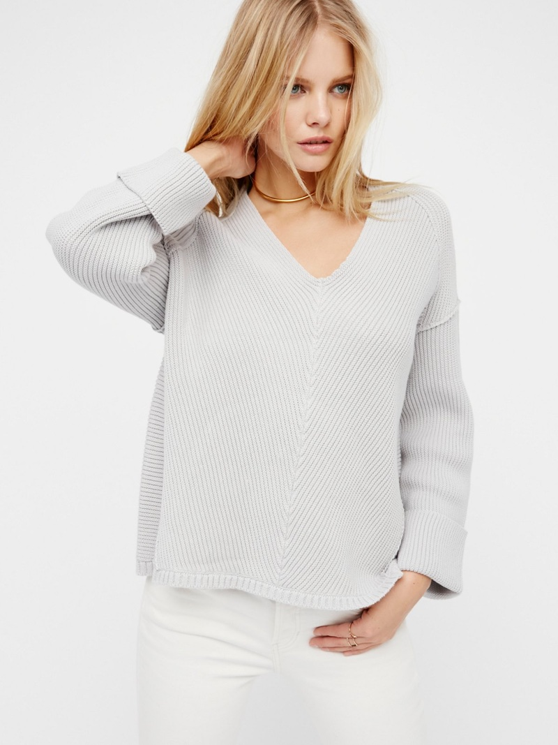 Free People's v-neck sweater also comes in a light grey color