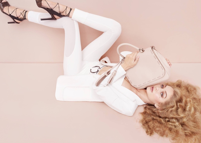 Suiting up, Gigi Hadid appears in Max Mara Accessories' spring 2017 advertising campaign