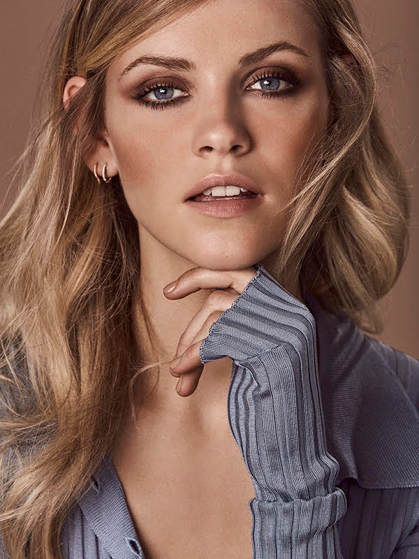 Model Ginta Lapina wears her hair in wavy tresses
