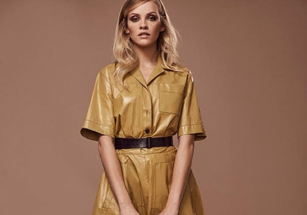Ginta Lapina poses in shirt dress with utilitarian accents