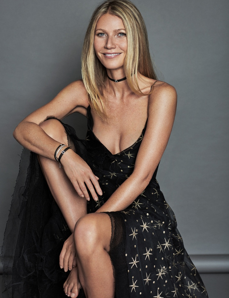 All smiles, Gwyneth Paltrow wears Valentino gown and Tous choker necklace