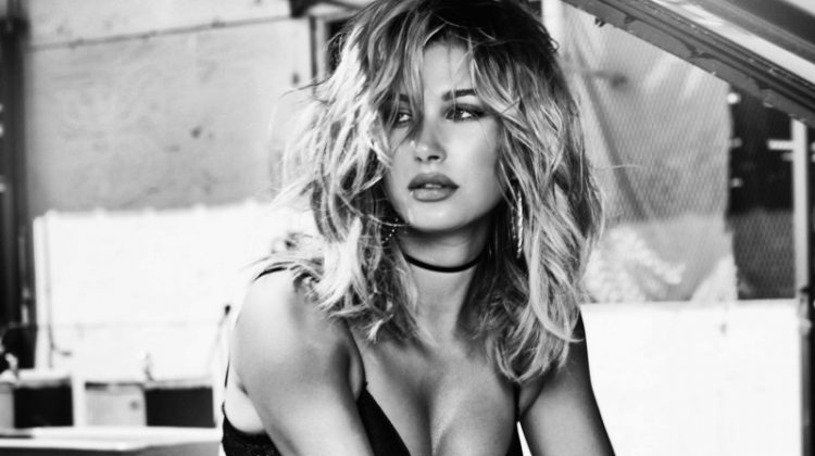 Hailey Baldwin smolders in bra and jeans for Guess' 35th anniversary advertising campaign