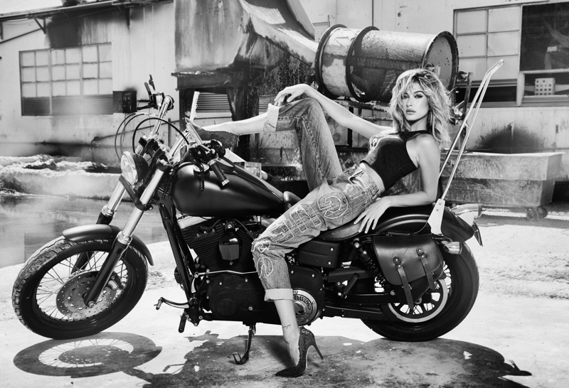 Posing on a motorcycle, Hailey Baldwin lounges in Guess' 35th anniversary campaign
