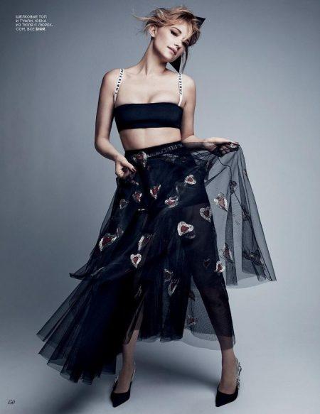 Haley Bennett poses in Dior bralette, embellished skirt and pumps