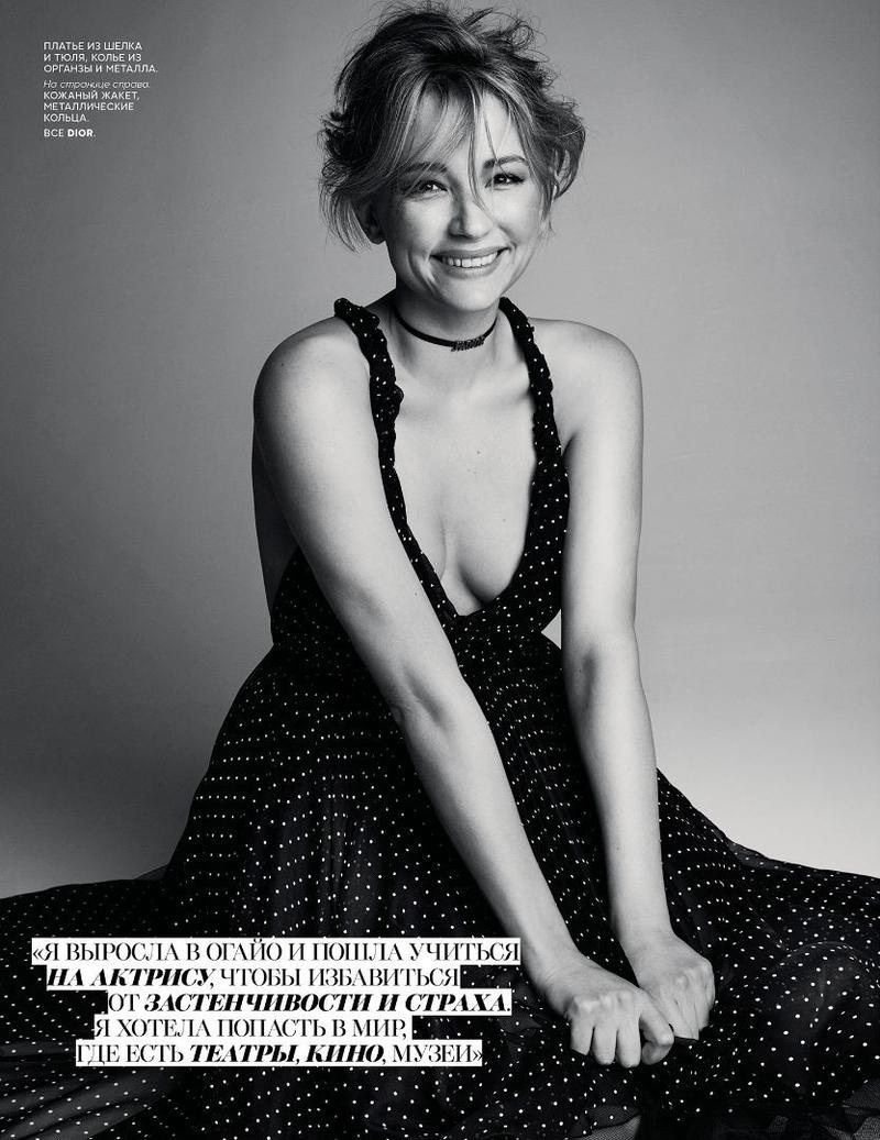 All smiles, Haley Bennett poses in Dior polka dot print gown and choker necklace